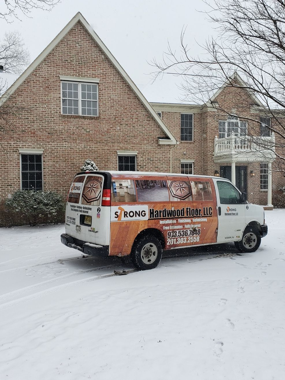 Strong Hardwood Floors Work Van