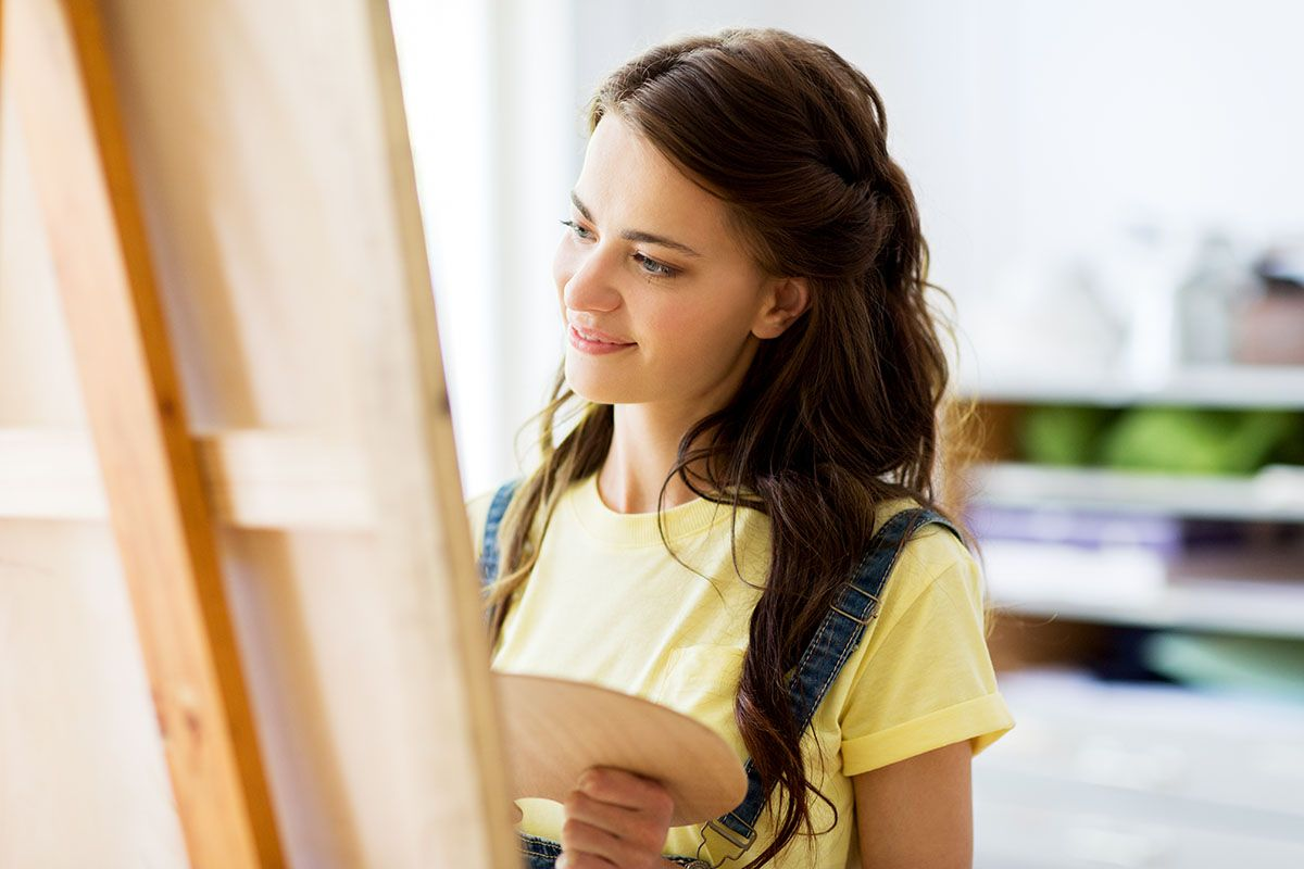 Picture of young female painting.