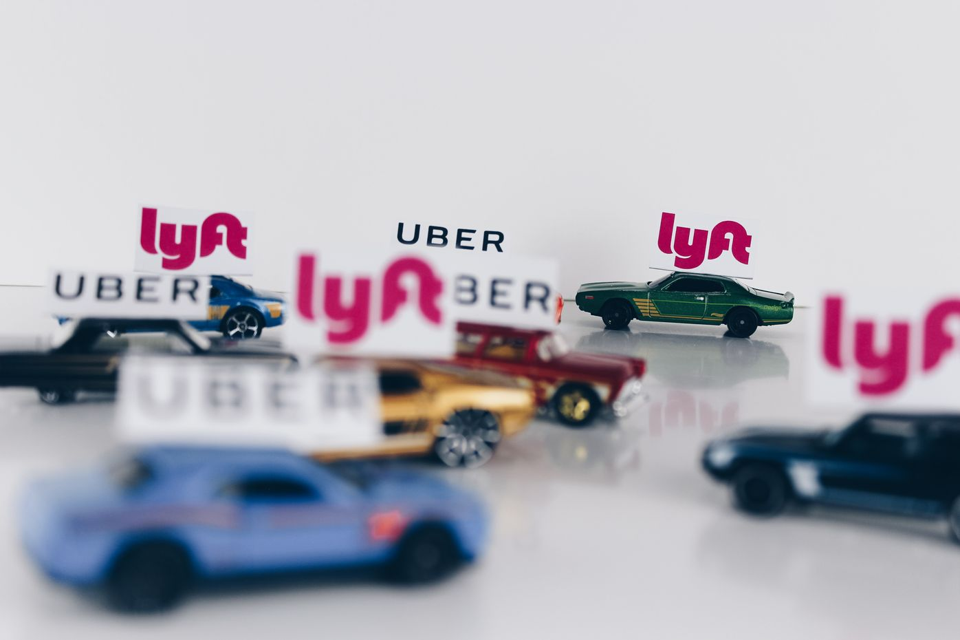 Cover photo with Uber and Lyft cars